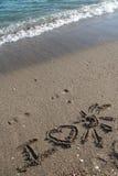 Я люблю солнце написанное в песке Стоковые Фото