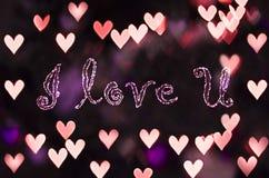Я люблю u на bokeh сердца - предпосылку дня валентинок Стоковая Фотография RF