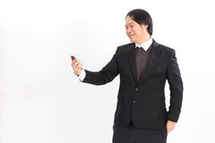 ณหนสฟะำก Smiling bussiness man looking at his smart phone Stock Photography