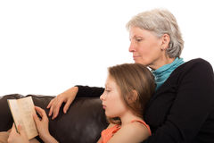 Grandmother read a book with her granddaughter royalty free stock photos