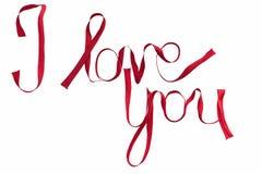 '我爱你'写与红色丝绸丝带 免版税库存图片