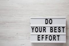 'Haga las palabras de su mejor esfuerzo 'en lightbox sobre el fondo de madera blanco, visión superior De arriba, desde arriba End fotos de archivo libres de regalías