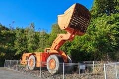'Um bogger ', um motor gigante da terra da parte frontal fotografia de stock royalty free