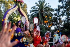 `Valencia, Spain`; 07 29 2019: Flowers Battle Parade. Fallas celebration. Floats parade and people throw flowers