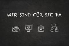 'Wir sind de tekst en de pictogrammen van Sie für DA 'op een bord Vertaling: 'Wij zijn daar voor u ' vector illustratie