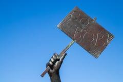 """""""Πηγαίνει το σημάδι βαριδιών """"στο άγαλμα του προσώπου που ενθαρρύνει στοκ εικόνα"""
