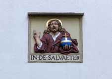 """IN DE SALVAETER "", su una parete in bianco bianca sul Begijnhof, Amsterdam immagini stock"