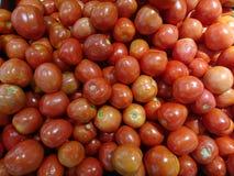 ‹Rosso di Tomatoes†nel mercato Fotografia Stock