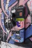 一个不能再用的公开投币式公用电话 库存图片