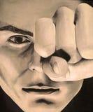 一个严肃的人的绘画用在乌贼属的一只闭合的手 免版税库存图片
