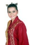 一个亚裔女孩的画象在传统土产部族婆罗洲穿戴了 库存图片