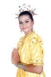 一个亚裔女孩的画象在传统土产部族婆罗洲穿戴了 库存照片