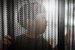 一个亚裔男孩行动是囚犯 图库摄影