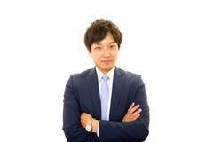 一个亚洲生意人的纵向 库存图片