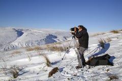 一个人拍摄与葡萄酒照相机的一张照片 库存图片