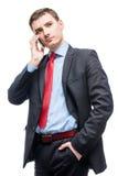 一个人的垂直的画象有电话的,企业家 图库摄影
