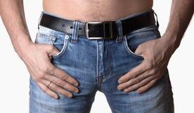 一个人的播种的图象牛仔裤的在白色背景 免版税库存照片