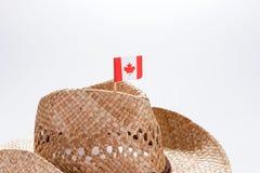 一个人的时兴的牛仔帽有加拿大的旗子的 库存照片