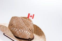 一个人的时兴的牛仔帽有加拿大的旗子的 库存图片