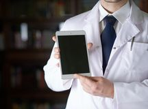 一个人的片段医生的外套的 库存照片