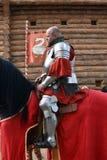一个人的画象历史服装的,他骑一匹黑马 库存图片