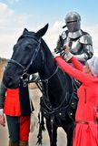 一个人的画象历史服装的,他骑一匹黑马 库存照片