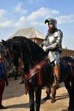一个人的画象历史服装的 他骑马 库存图片