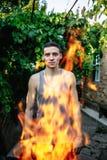 一个人的画象火火焰的  免版税库存照片