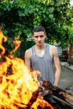 一个人的画象火火焰的  免版税库存图片