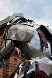 一个人的画象金属装甲的,后面看法 图库摄影