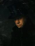 一个人的老照片有高顶丝质礼帽的 免版税库存照片