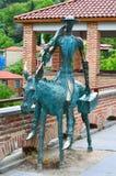 一个人的铜雕象驴的在西格纳吉 图库摄影