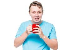 一个人的画象有一杯咖啡的在awak以后的早晨 图库摄影