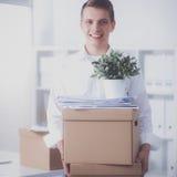 一个人的画象有移动的箱子和其他材料的在白色 图库摄影