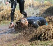 一个人落入泥 免版税图库摄影