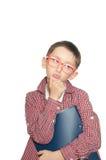 一个体贴的年轻男孩的画象有书的 库存图片
