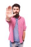 一个偶然有胡子的行家人陈列停车牌的画象 库存照片