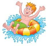 一个内胎的男孩在水中 库存照片