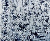 从一个冷淡的样式的背景在玻璃冬天 图库摄影