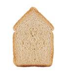 一个切片在白色在房子标志的麦子面包隔绝的 库存图片