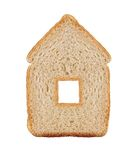 一个切片在白色在房子标志的麦子面包隔绝的 库存照片