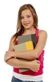 微笑的女孩拿着书被隔绝 免版税图库摄影