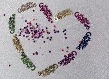 一个十岁的女孩做的圣诞节装饰的心脏 图库摄影