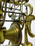 一个古色古香的最基本的时钟的推进嵌齿轮 库存图片
