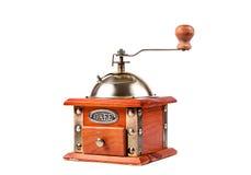 一个古色古香的磨咖啡器的照片在白色的 库存照片