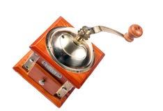 一个古色古香的磨咖啡器的照片在白色的 免版税库存照片