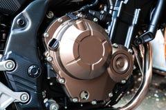 一个古铜色摩托车引擎 免版税库存图片