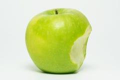 一个叮咬绿色苹果 库存照片