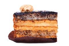 一个可口生日切片蛋糕,隔绝在白色背景 与装饰的开胃蛋糕在上面 甜的点心 库存照片
