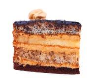 一个可口生日切片蛋糕,隔绝在白色背景 与装饰的开胃蛋糕在上面 甜的点心 库存图片